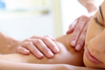 Part of face of calm female having massage