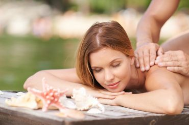 Woman receiving massage on pier